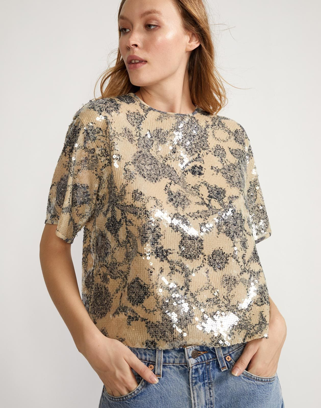 Front view of sequin embroidered floral motif tee