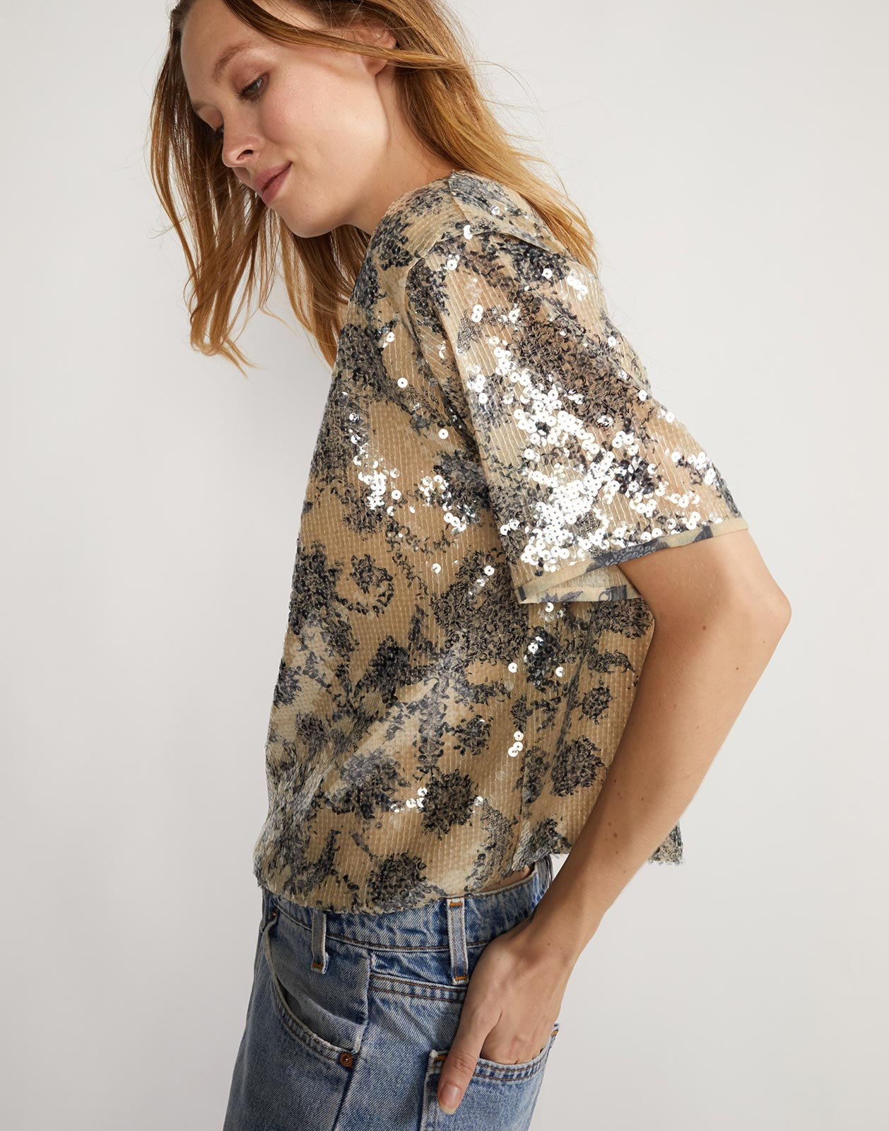 Side view of short sleeved floral shirt