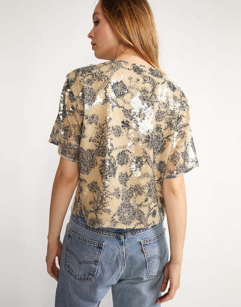 Back view of slightly cropped sequin embroidered tee