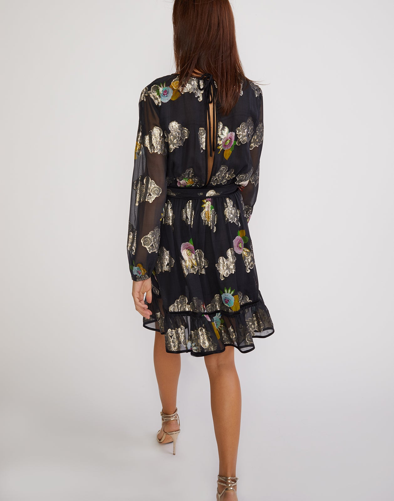 Full back view of the sheer metallic floral print dress with ruffle flounce bottom