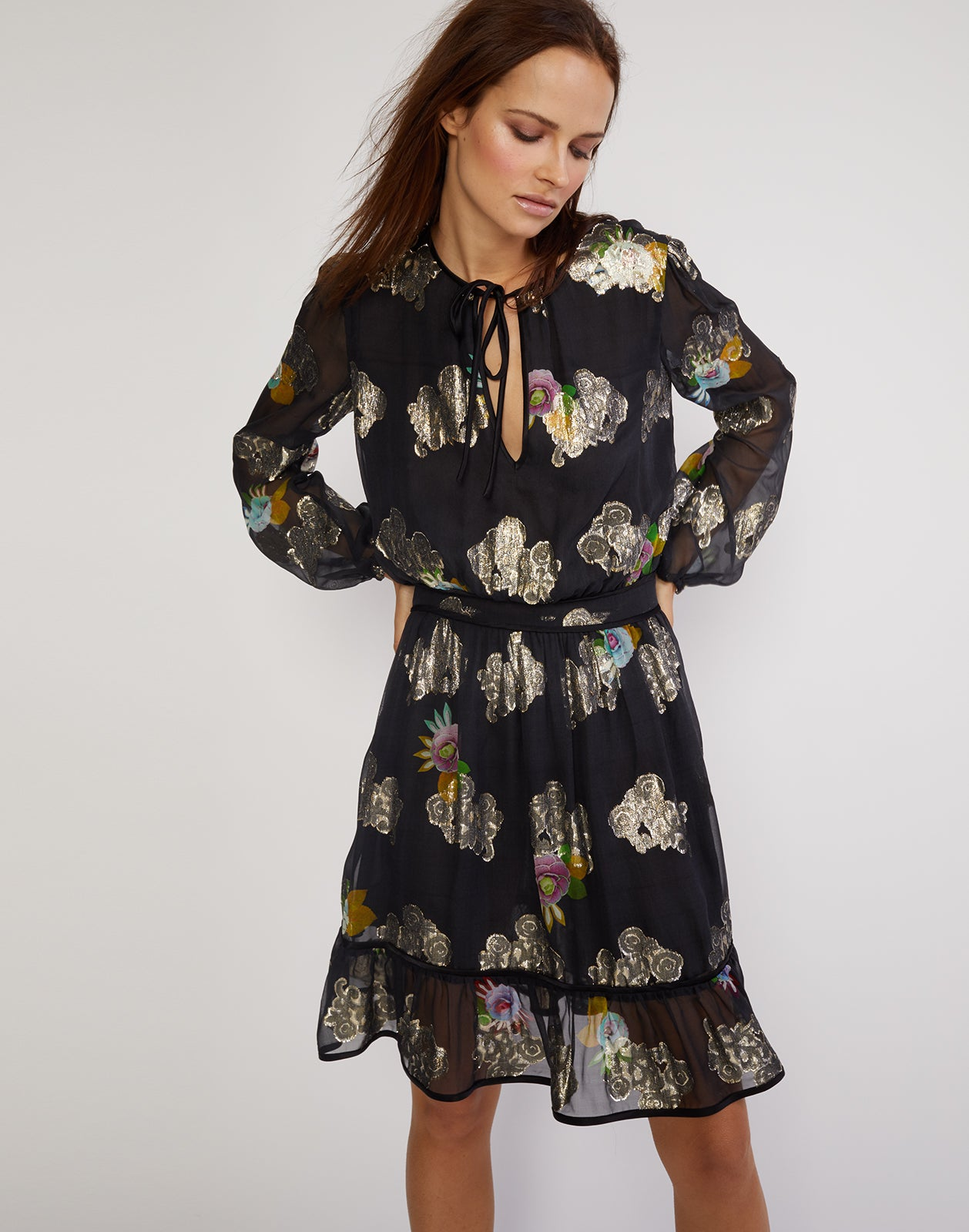 Front view of the sheer metallic floral print dress with ruffle flounce bottom