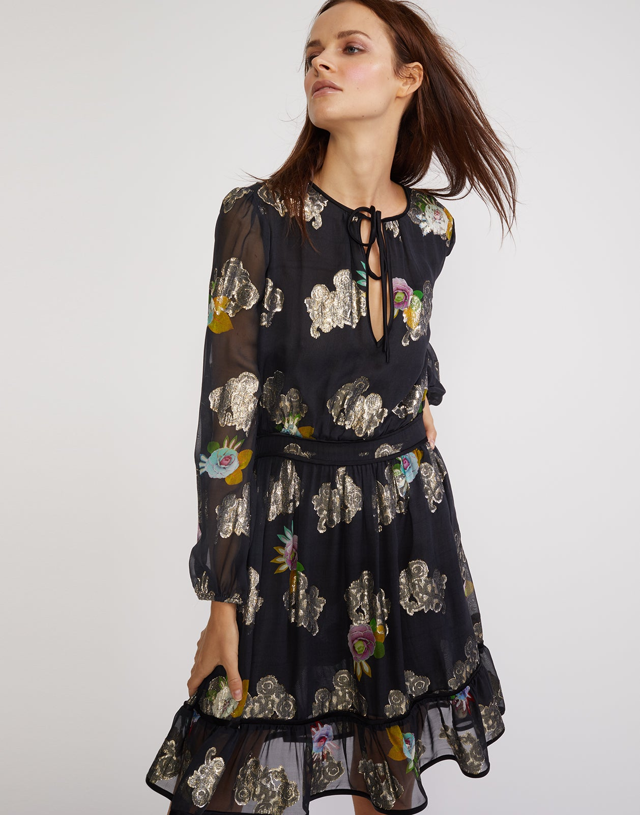 3/4 angled view of the sheer metallic floral print dress with ruffle flounce bottom