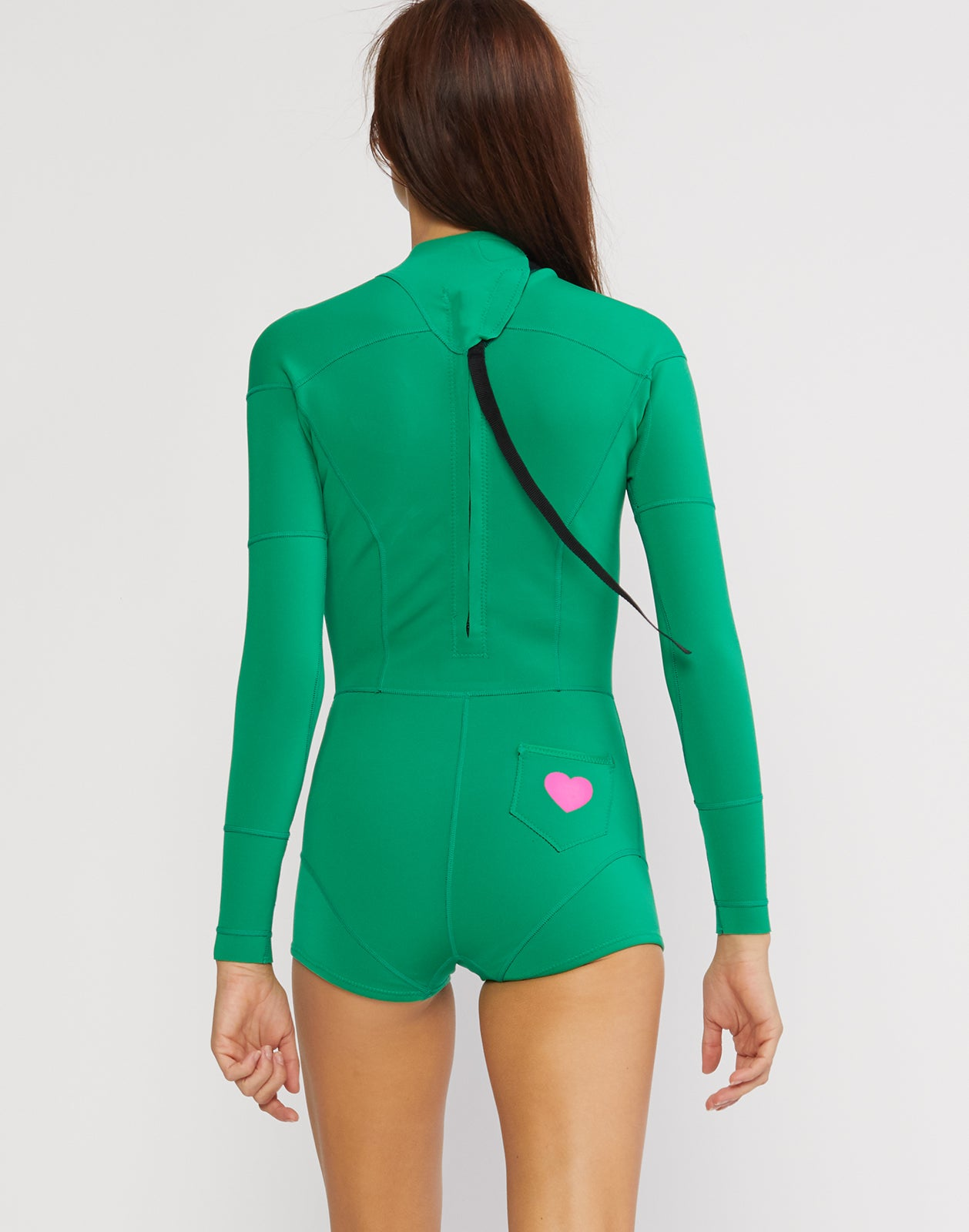 Back view of the kelly green neoprene wetsuit with mini back pocket and heart detail.