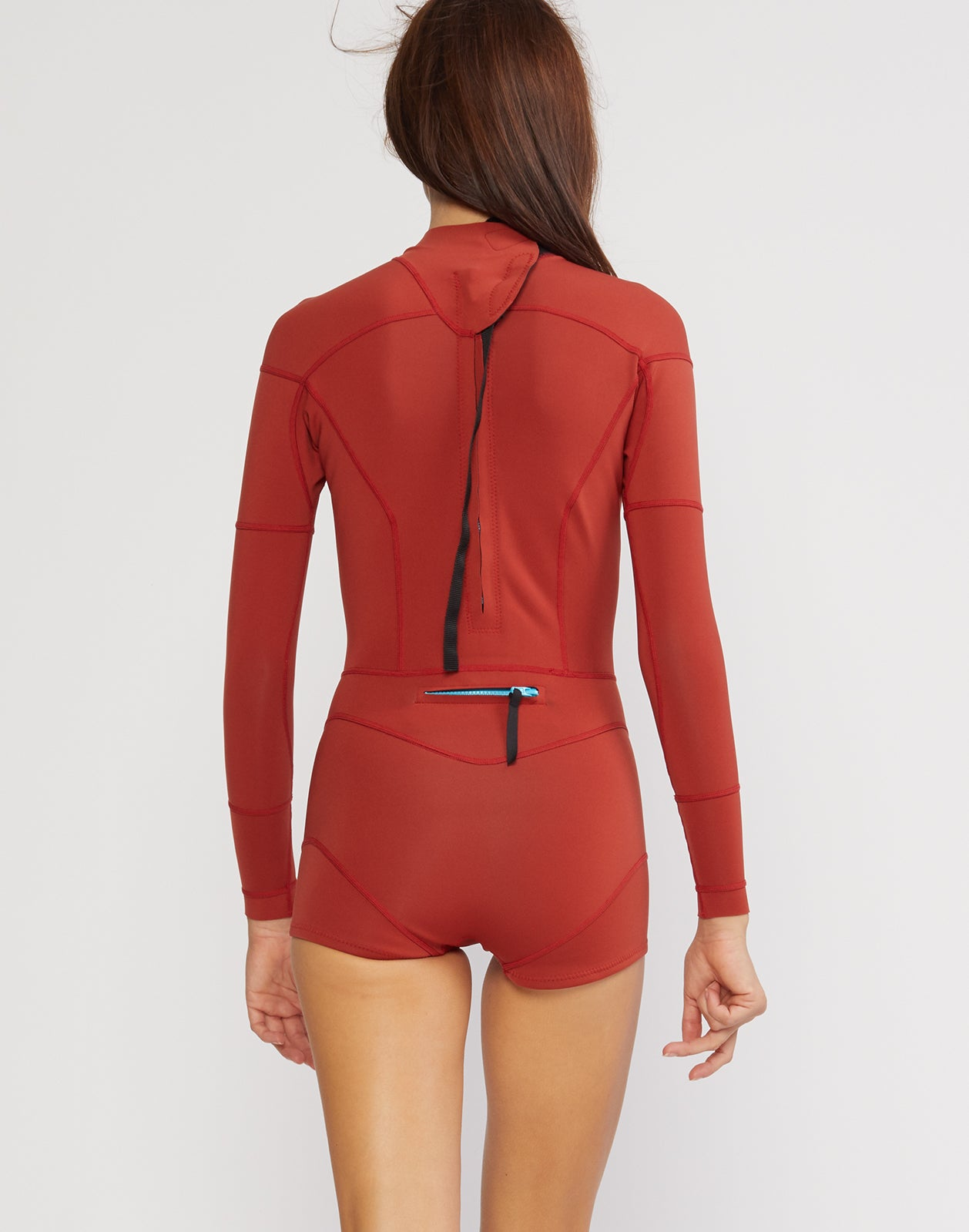 Back view of the solid neoprene wetsuit in rusty red.