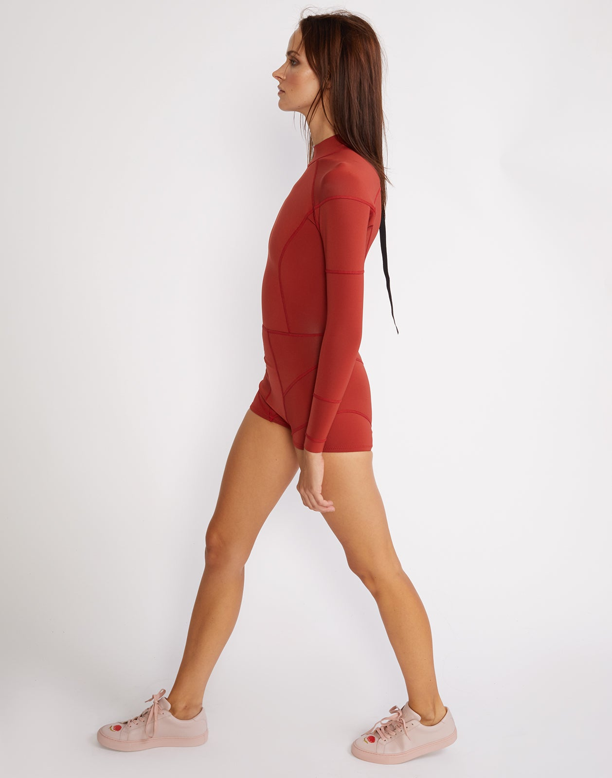 Side view of the solid neoprene wetsuit in rusty red.