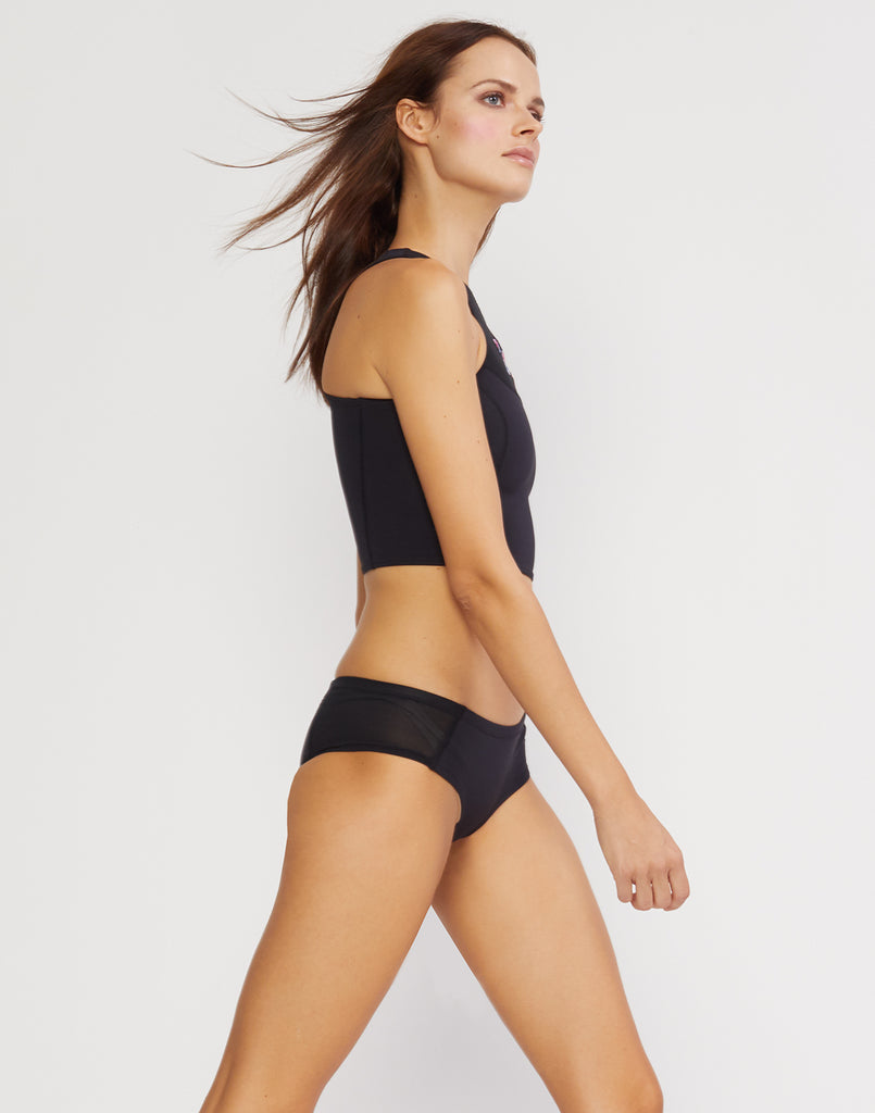 Side view of the neoprene bikini bottom with sheer mesh sides.