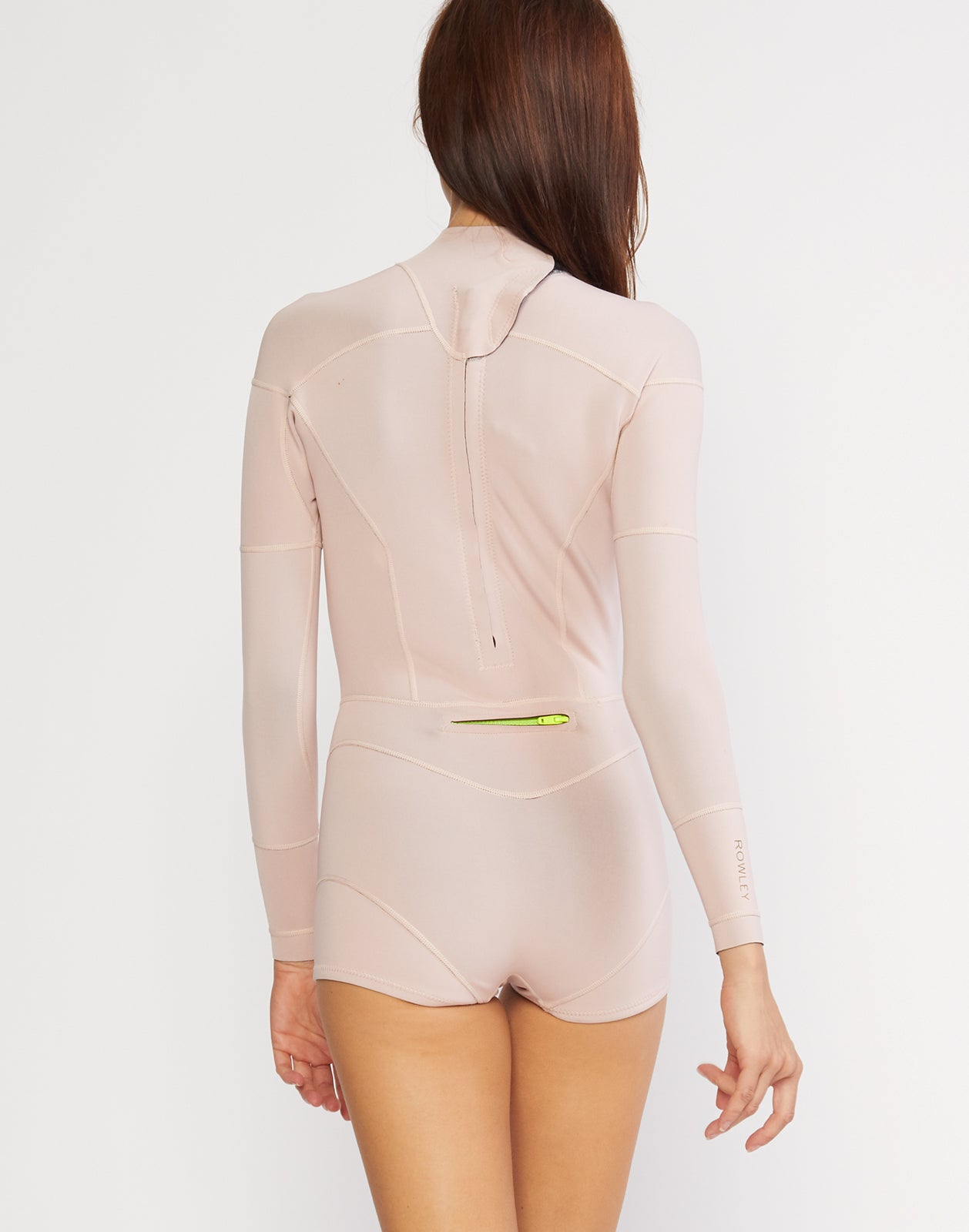 Back view of the solid neoprene wetsuit in rosebud pink.