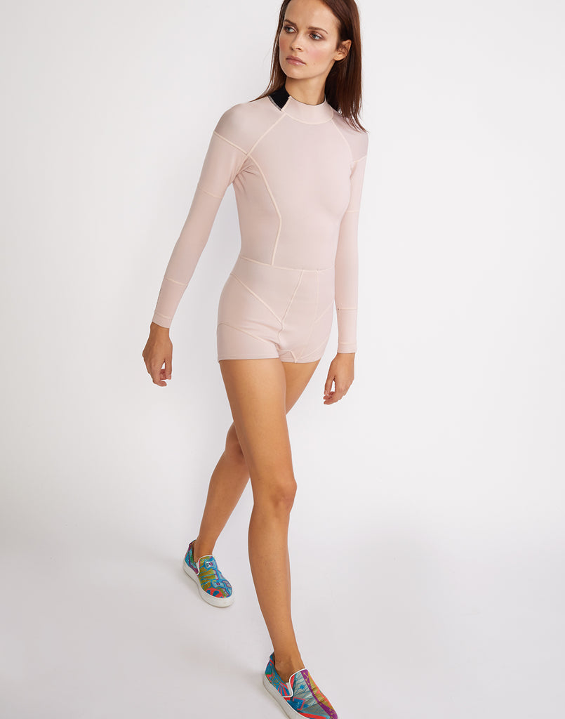 3/4 angle view of the solid neoprene wetsuit in rosebud pink.