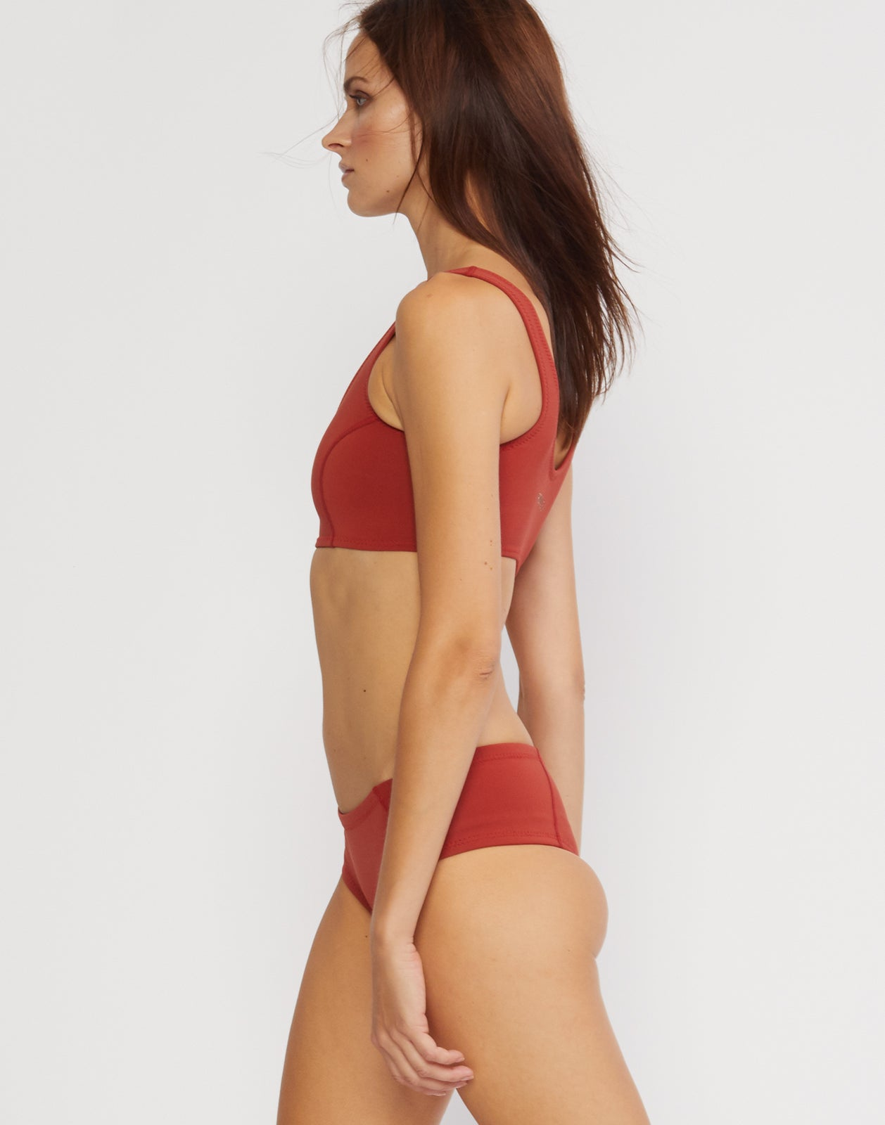 Side view of the neoprene low rise bikini bottom.