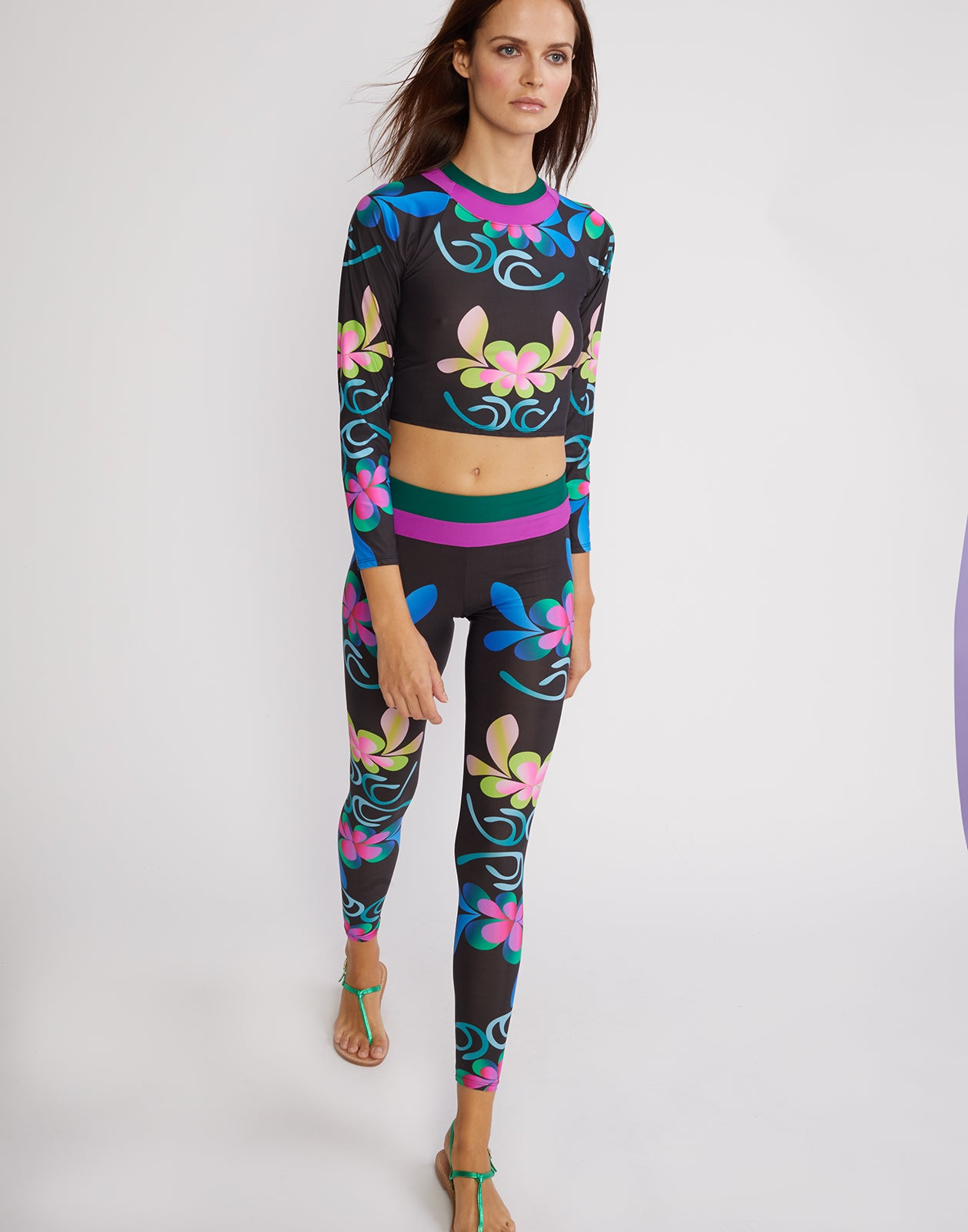 Front view of the electric floral print surf and fitness top.