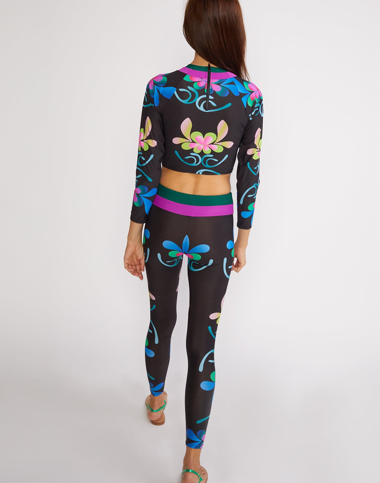 Full back view of the electric floral print surf and fitness legging.