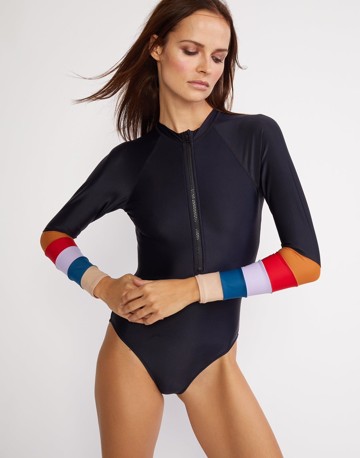 Front view of the surf suit with colorblock striped sleeves and front zipper.