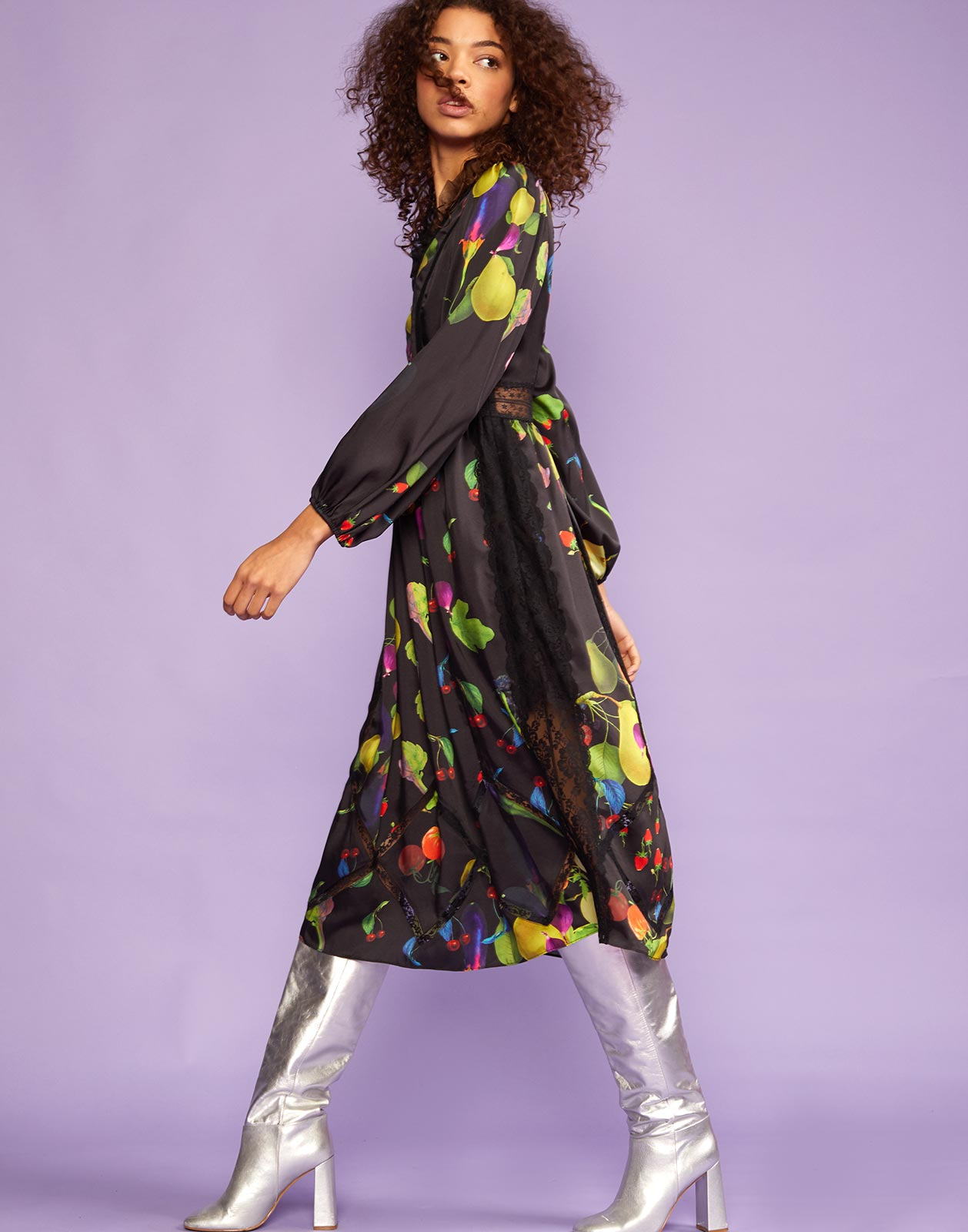 Side view of dark fruit maxi dress with long sleeves.