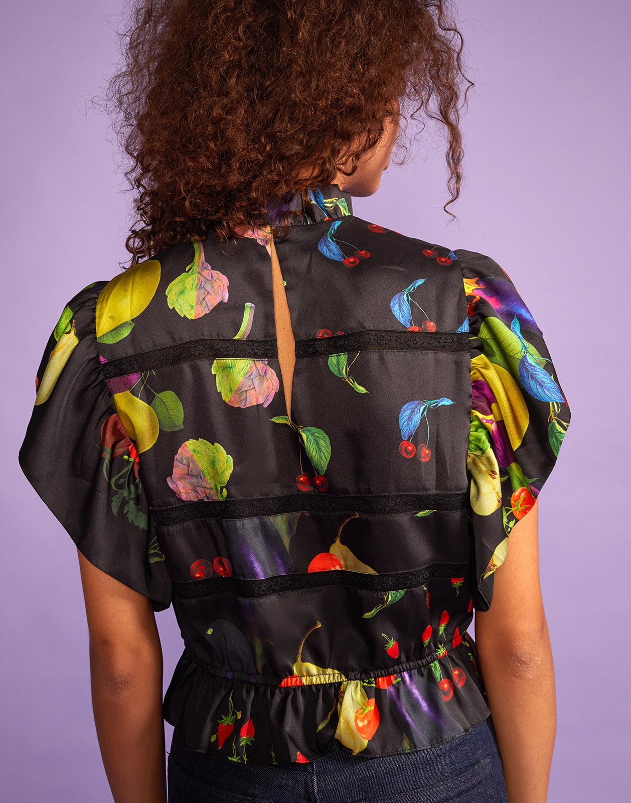 Back view of blouse with back keyhole closure