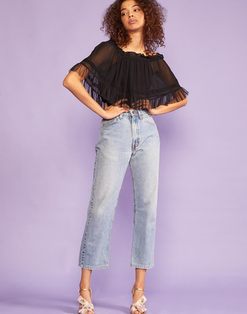 Full view of off shoulder cropped shirt with elasticized neckline