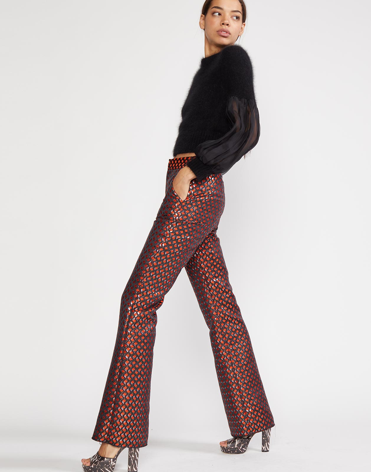 Side view of Geometric jacquard flare pant with side pockets at hips