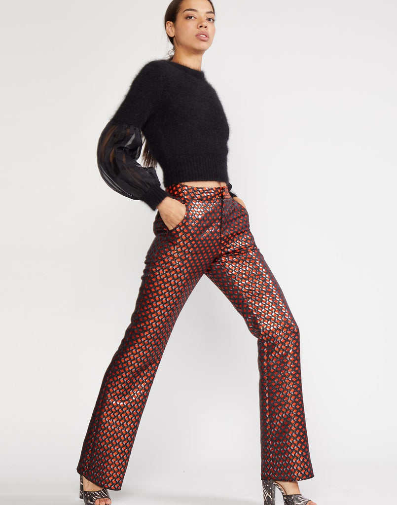 Model walking view of Geometric jacquard flare pant