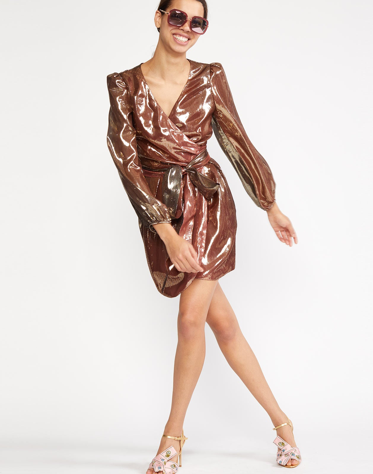 Bronze metallic lamé wrap dress with long sleeve shirred shoulder.
