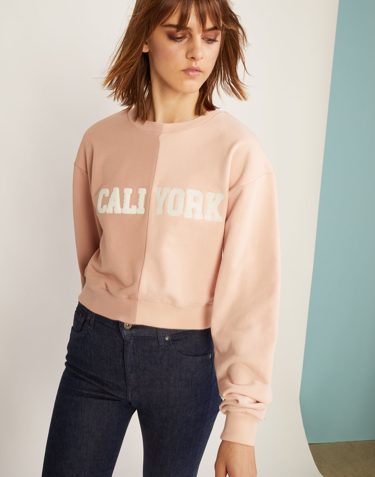 Front view of the half beige, half pink caliyork cropped sweatshirt in soft cotton.