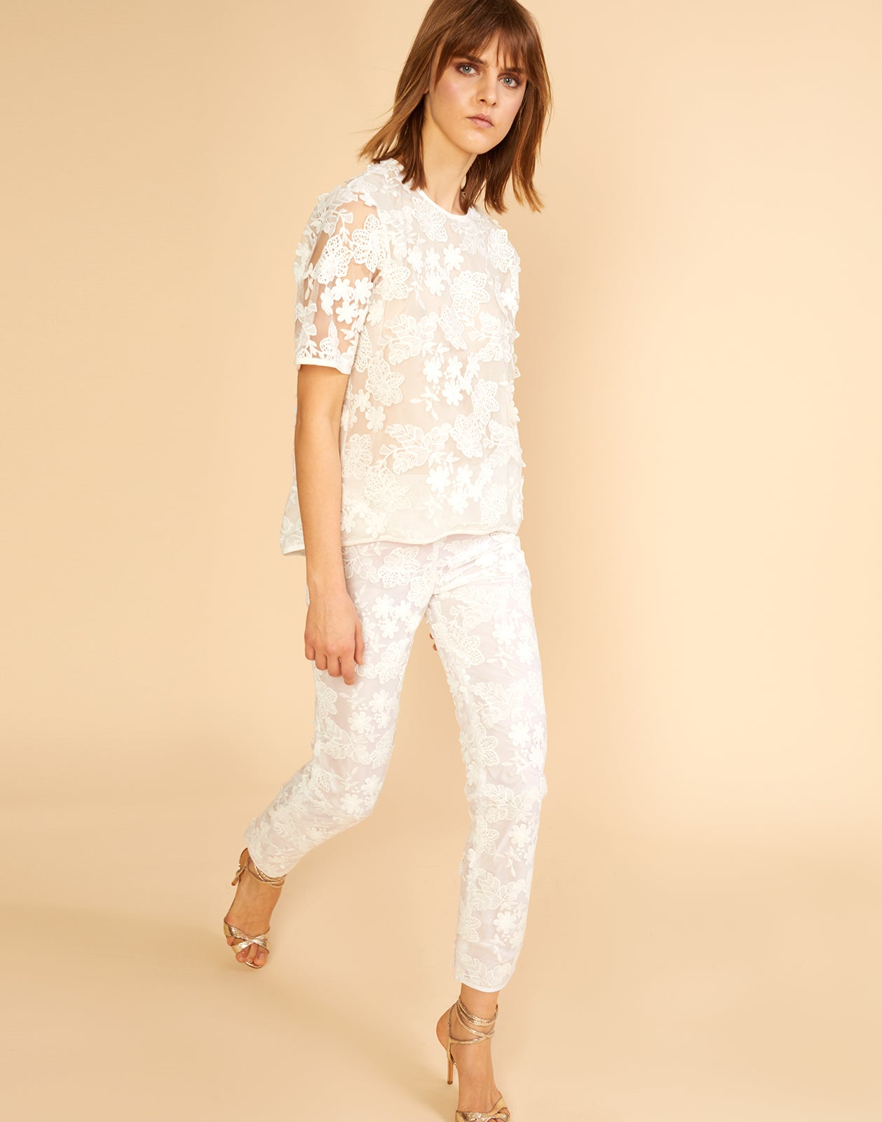 3/4 angled view of the floral lace pants with underlining.