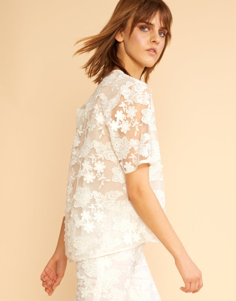Side view of Sheer floral lace tee.