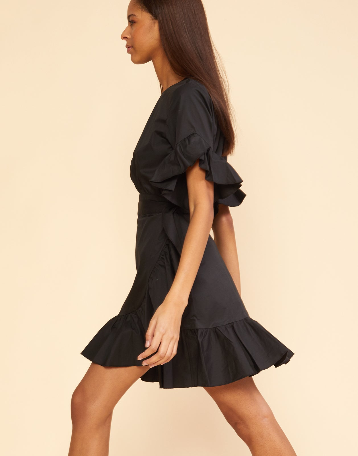 Left view of the polished cotton ruffle wrap dress