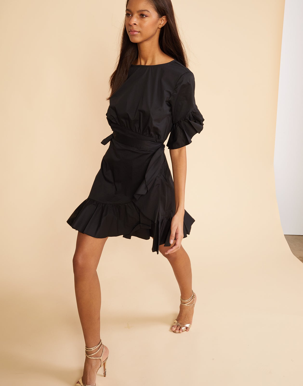3/4 full front view of the polished cotton ruffle wrap dress