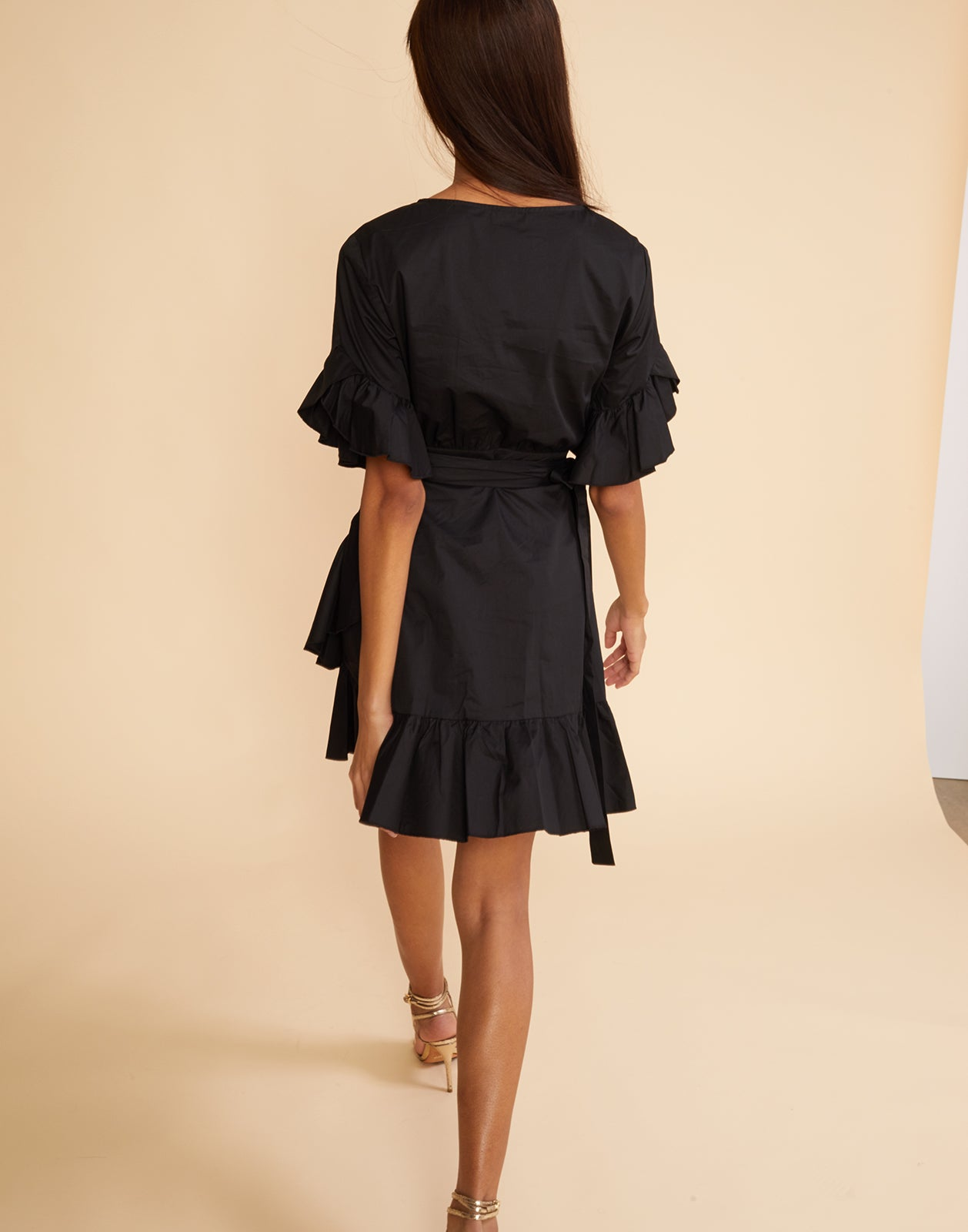 Back view of the polished cotton ruffle wrap dress