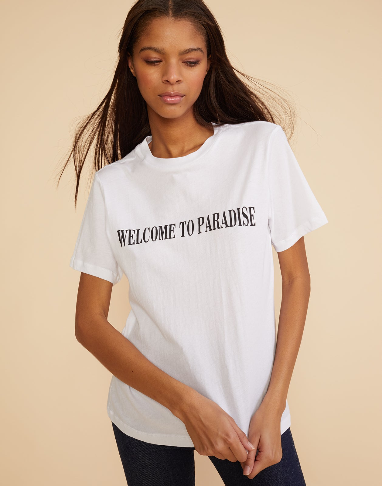 Front view of the soft crewneck tee with 'welcome to paradise' printed across the front.