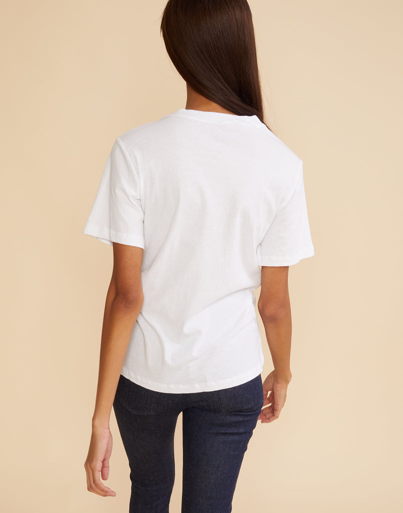 Back view of model wearing 'MOMTAUK' tee with blank white back
