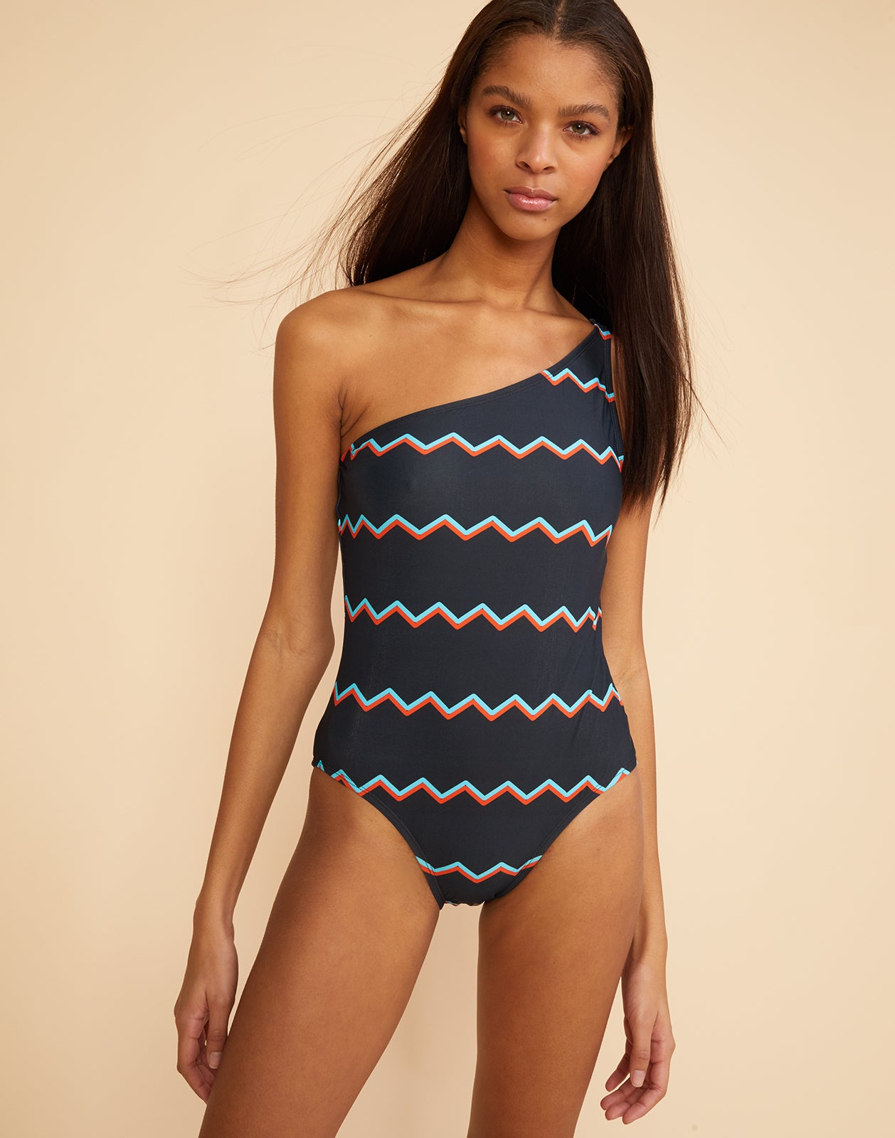 Front view detail of the chevron stripe one-shoulder swimsuit.