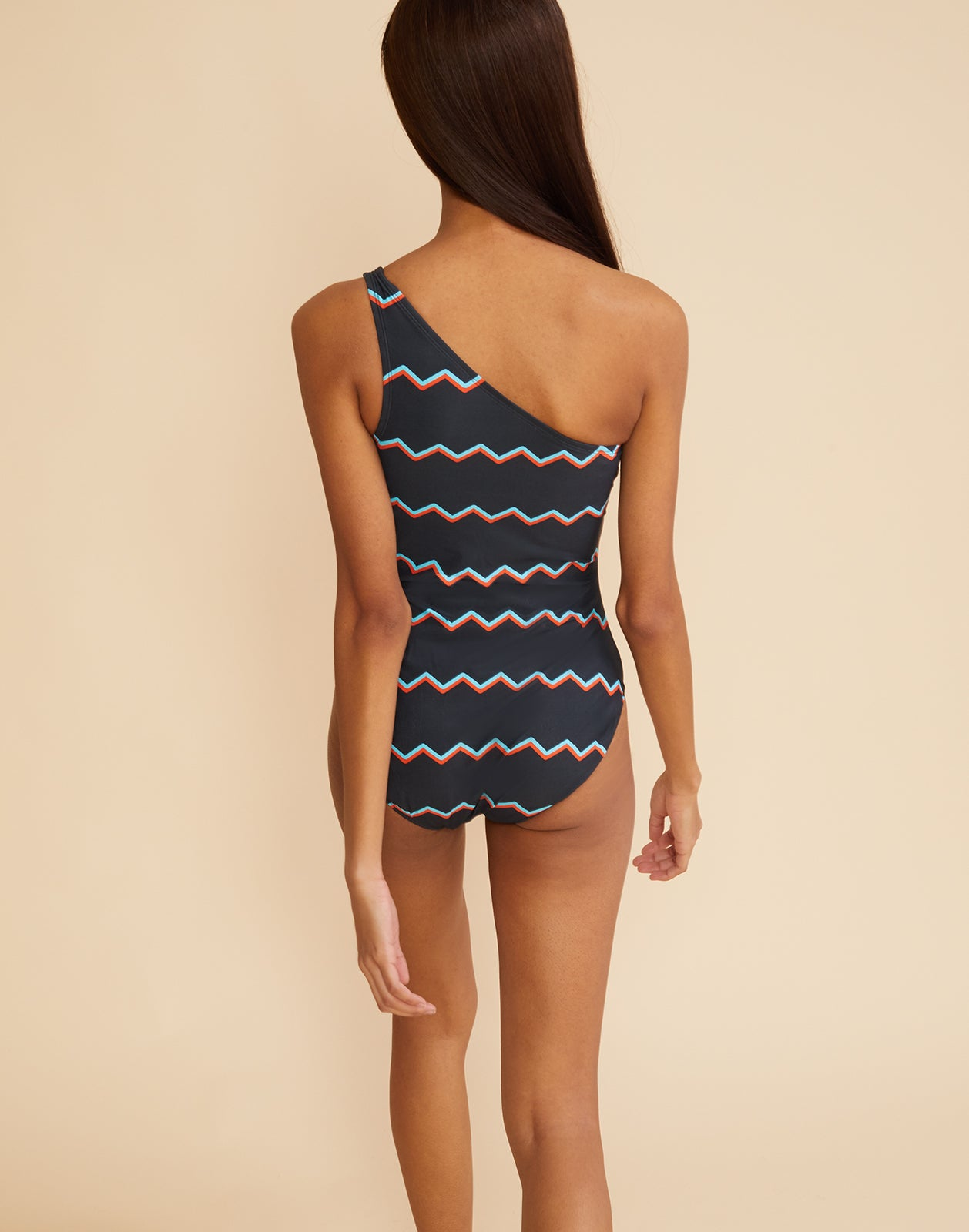 Back view of the chevron stripe one-shoulder swimsuit.