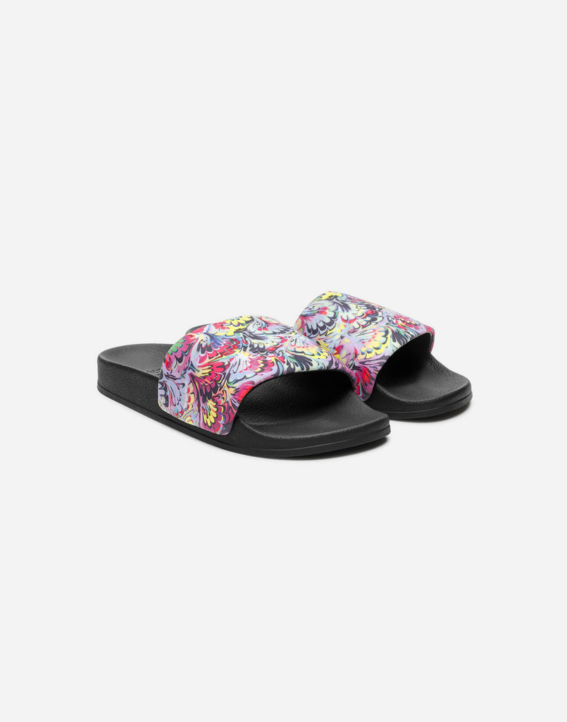 Product image of CR x Greats marble print neoprene slides.