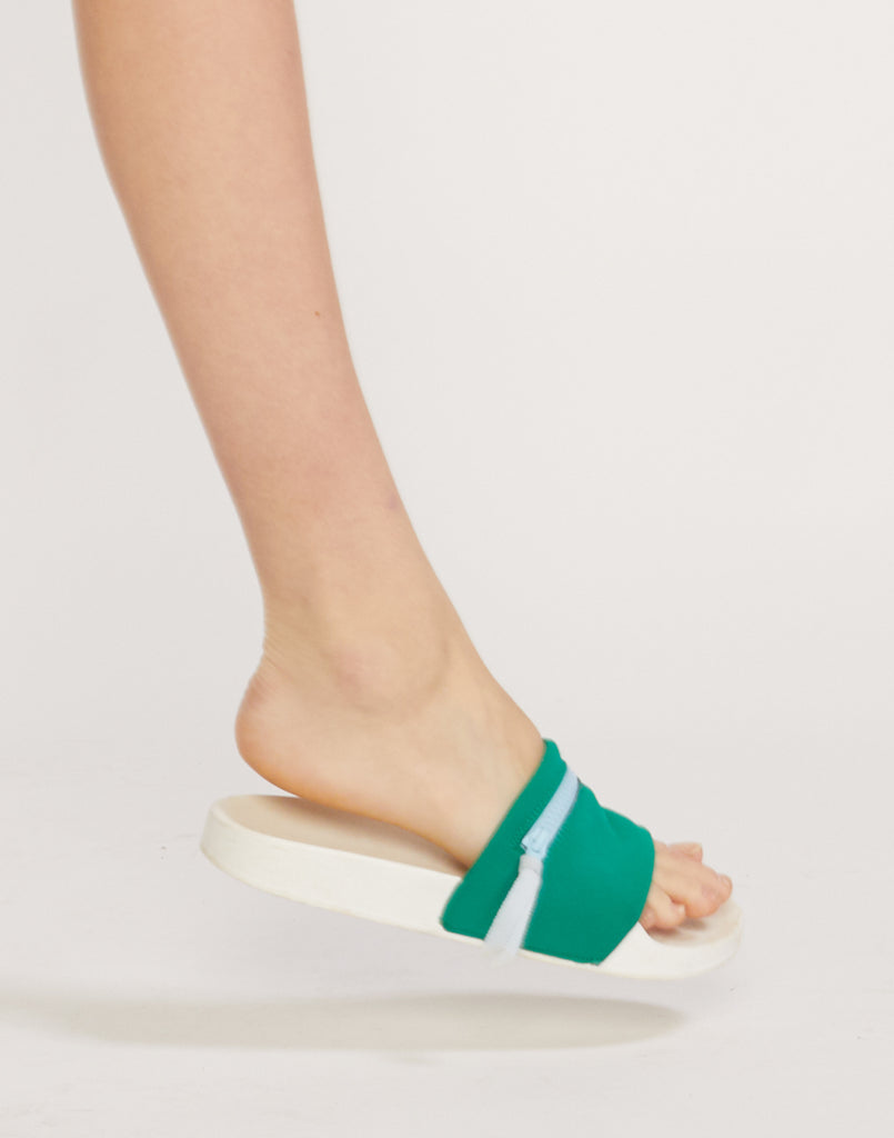 Side view of green neoprene slides on model.