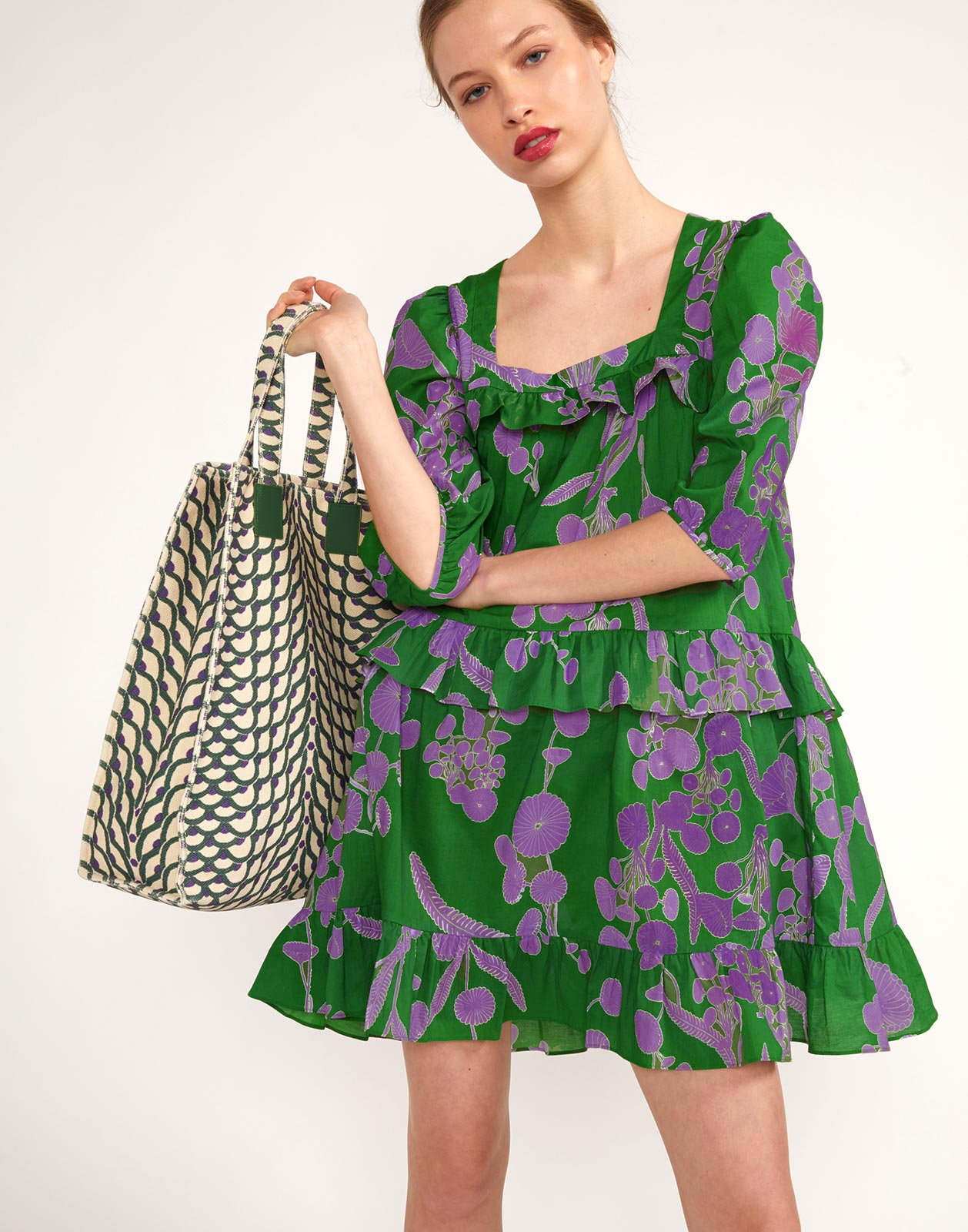 Printed green tote and Kuaii Ruffle Swing Dress