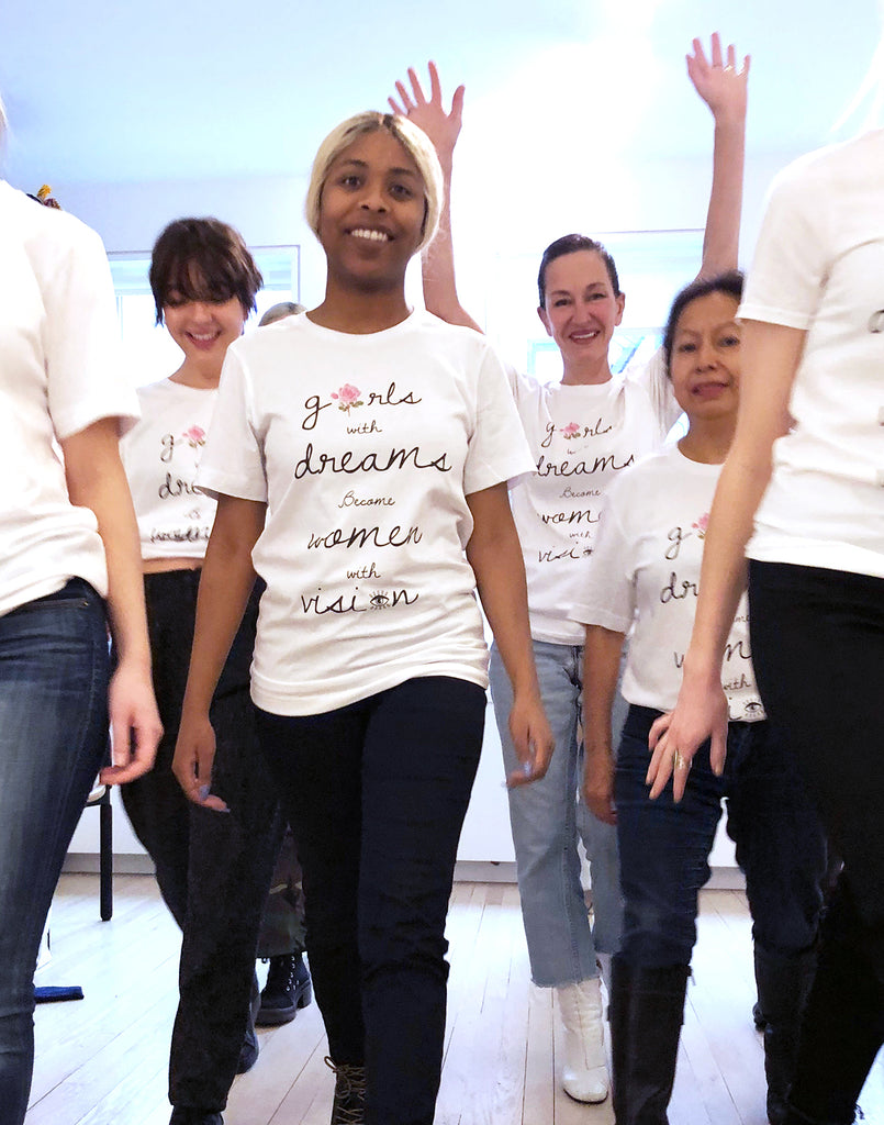 Cynthia Rowley and five other women wearing t-shirts with 'girls with dreams become women with vision' printed down the front