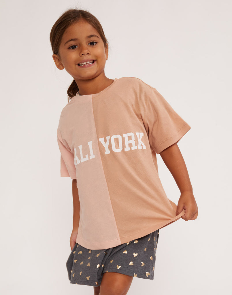 Kid's CaliYork tee in half pink and half beige.
