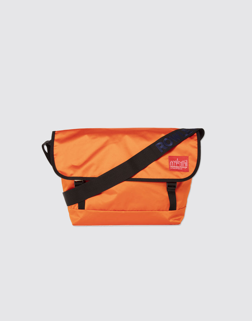 Front detail shot of Blood Orange Manhattan Portage Messenger Bag with front buckle and arm strap.