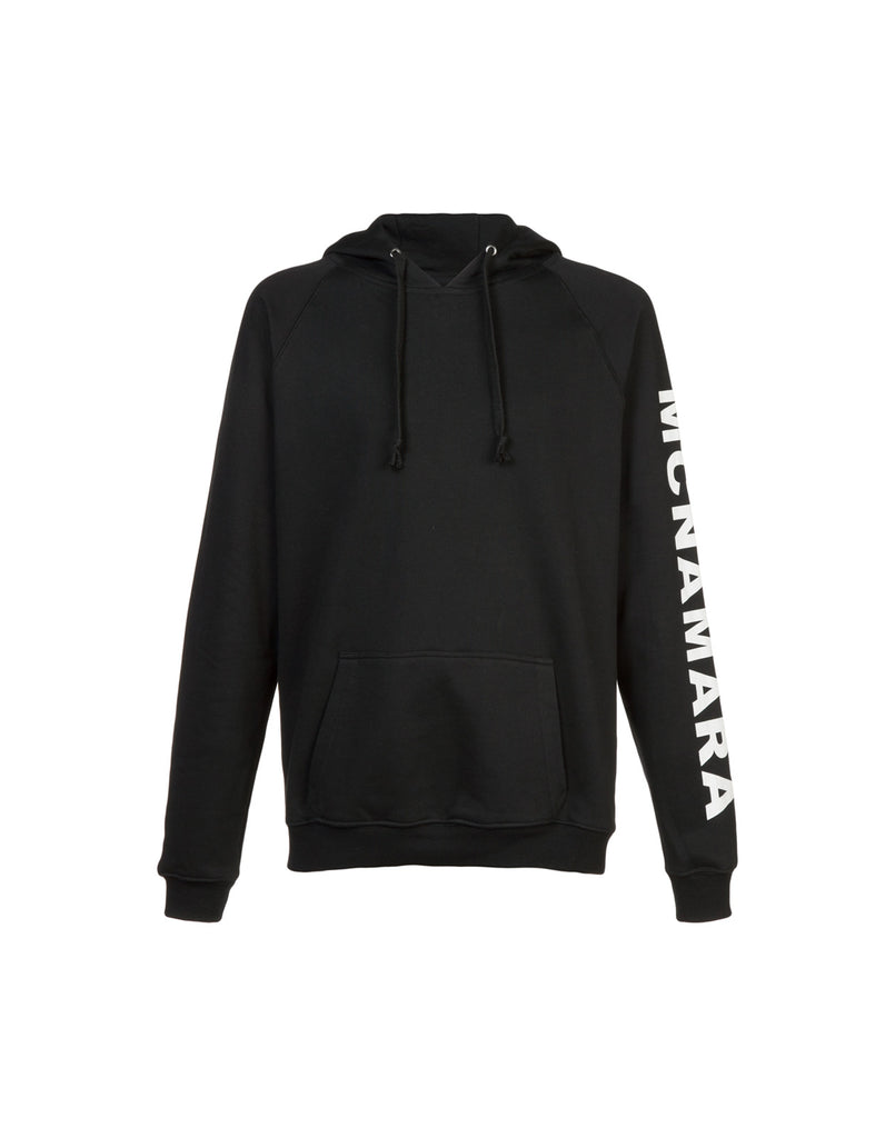 Black hoodie sweatshirt with MCNAMARA printed down one sleeve.