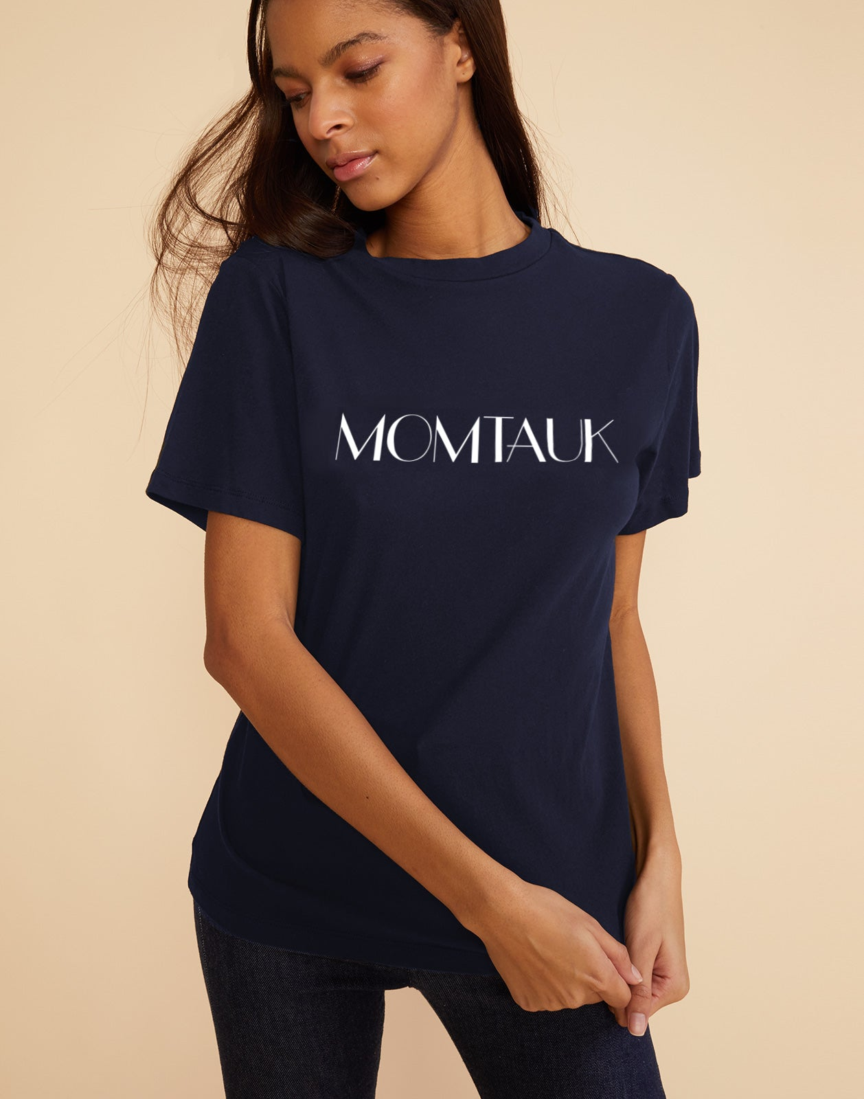 Model wearing navy cotton tee with 'momtauk' printed across the front