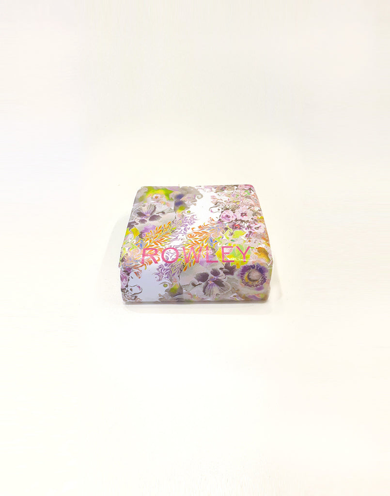 Rowley surf wax with light floral print wrapper.