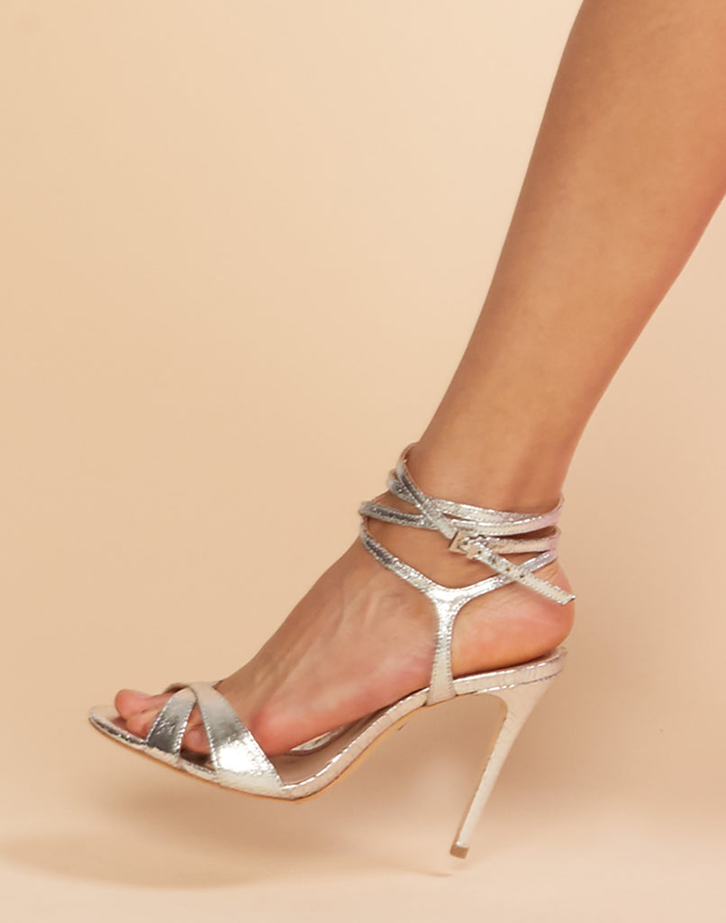 Side view of Athany high heel sandal in silver.