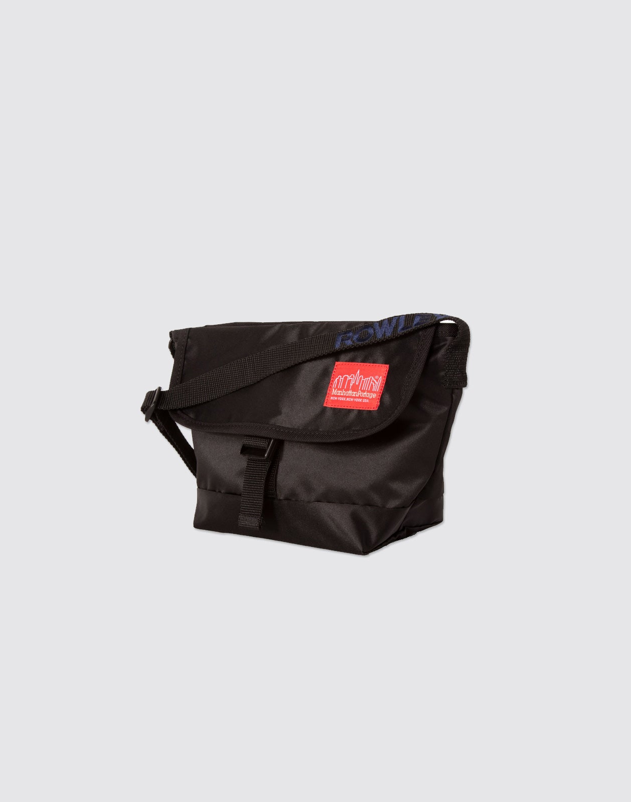 Diagonal side shot of Black Mini Manhattan Portage Messenger Bag with front buckle and arm strap.