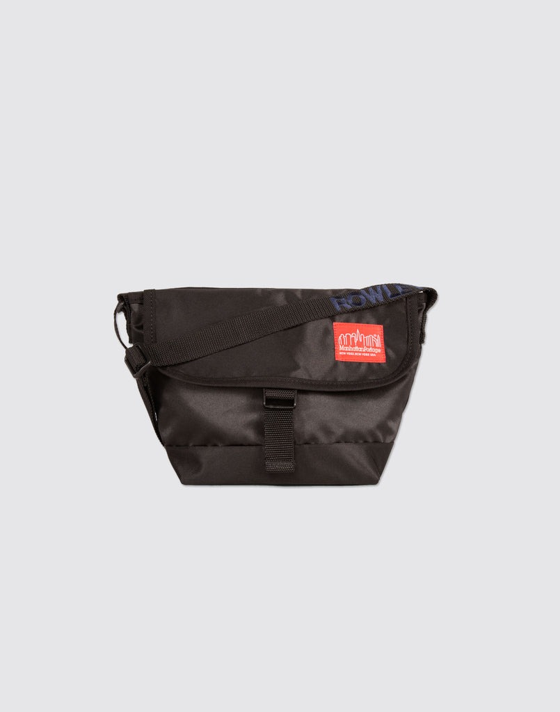 Front detail shot of Black Mini Manhattan Portage Messenger Bag with front buckle and arm strap.