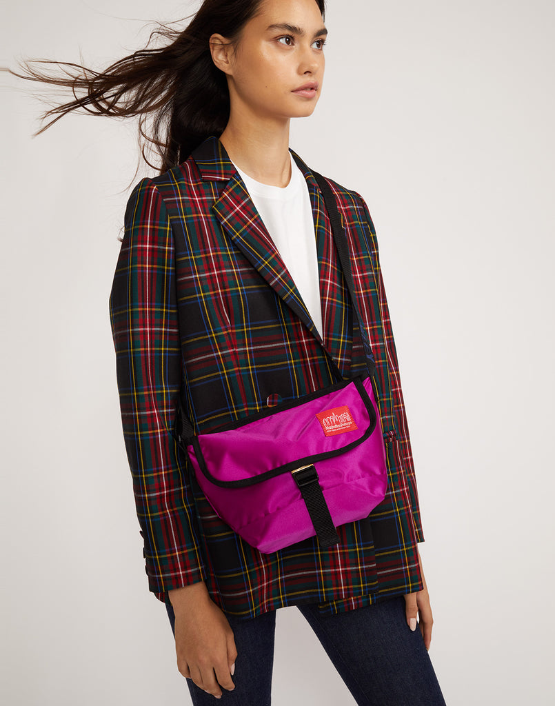 ROWLEY x Manhattan Portage mini messenger bag in ultraviolet worn cross body.