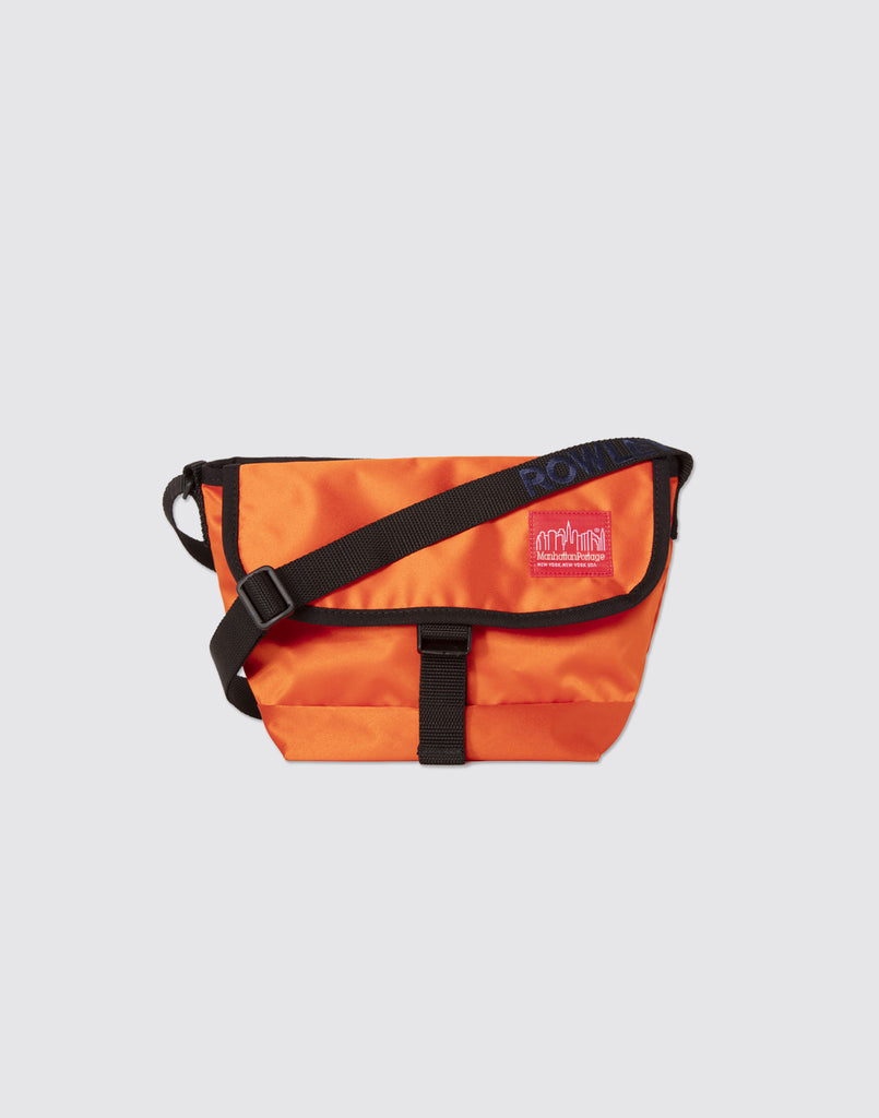 Front detail shot of blood orange mini manhattan portage messenger bag with  front buckle and arm dec3be36bcdb2