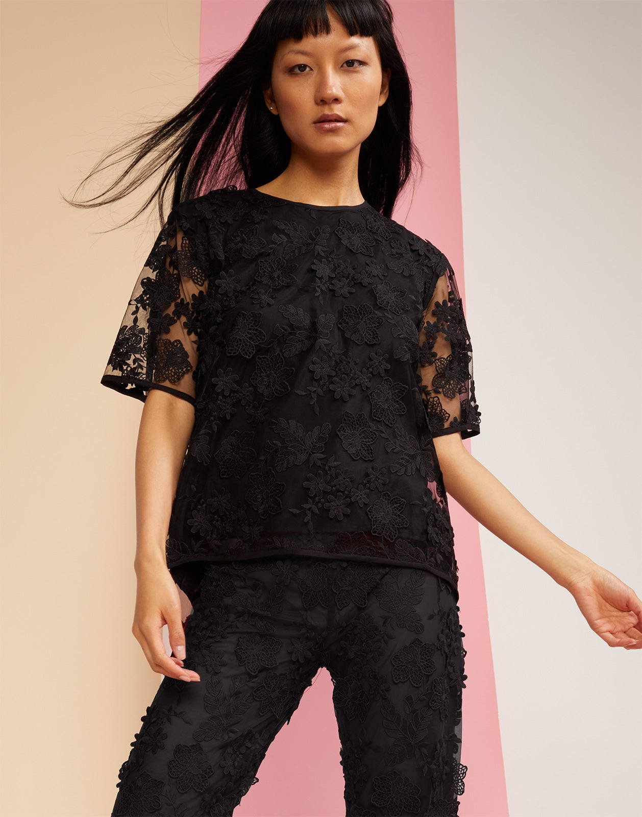 Close view of the floral lace Crossfade lace tee in black.