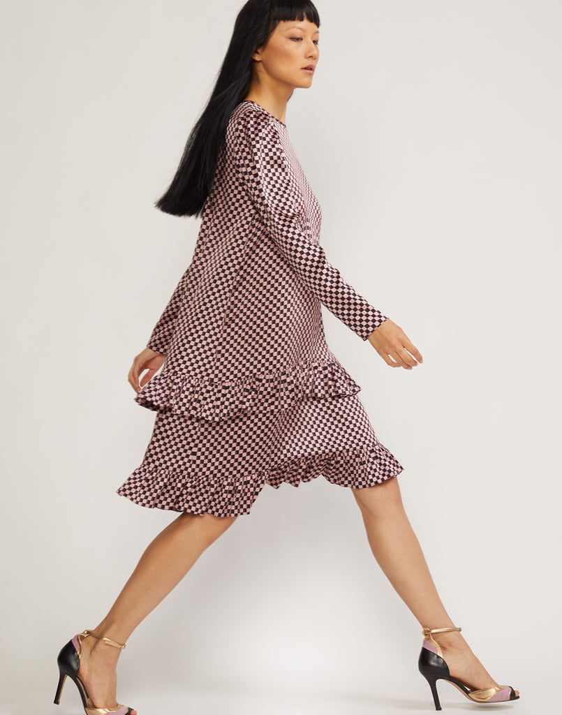 Side view of Off the Cuff double ruffle dress.