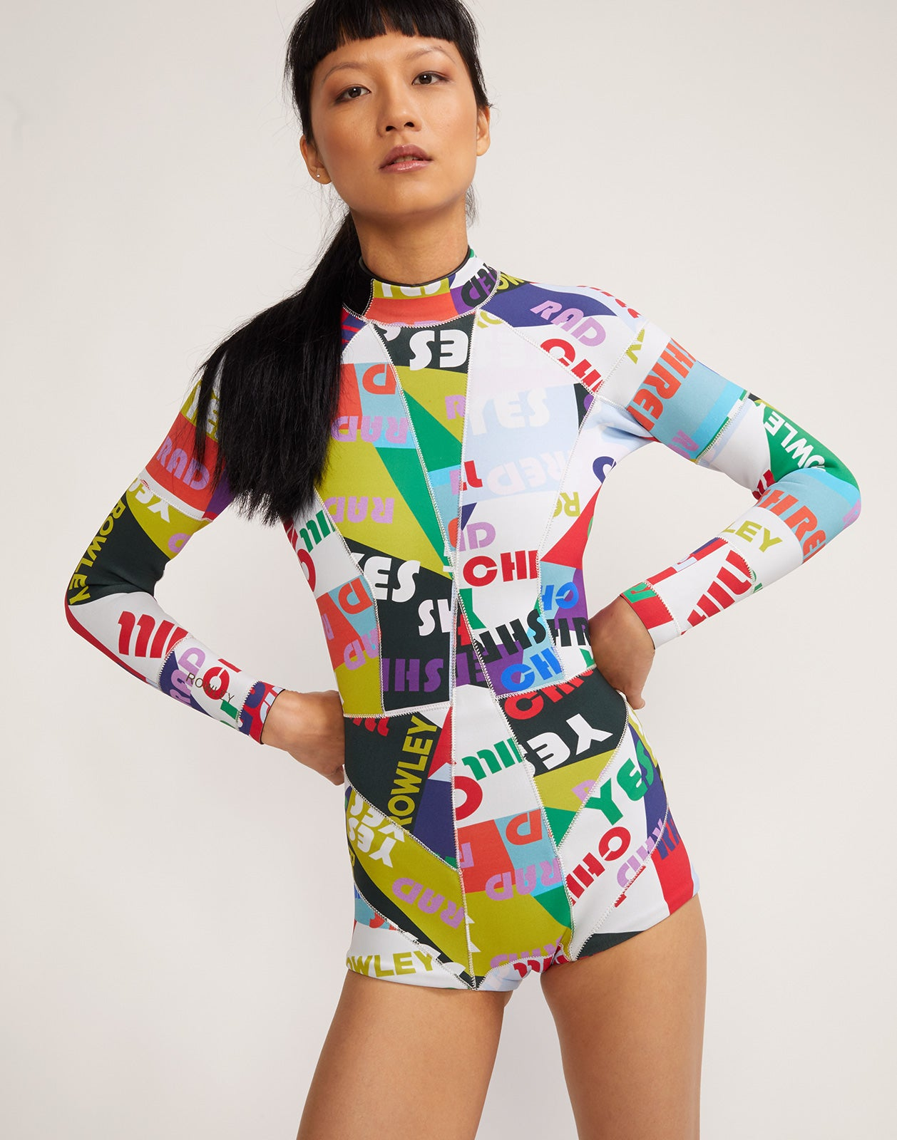 Close front view of Good Vibes wetsuit in colorful graphic print.