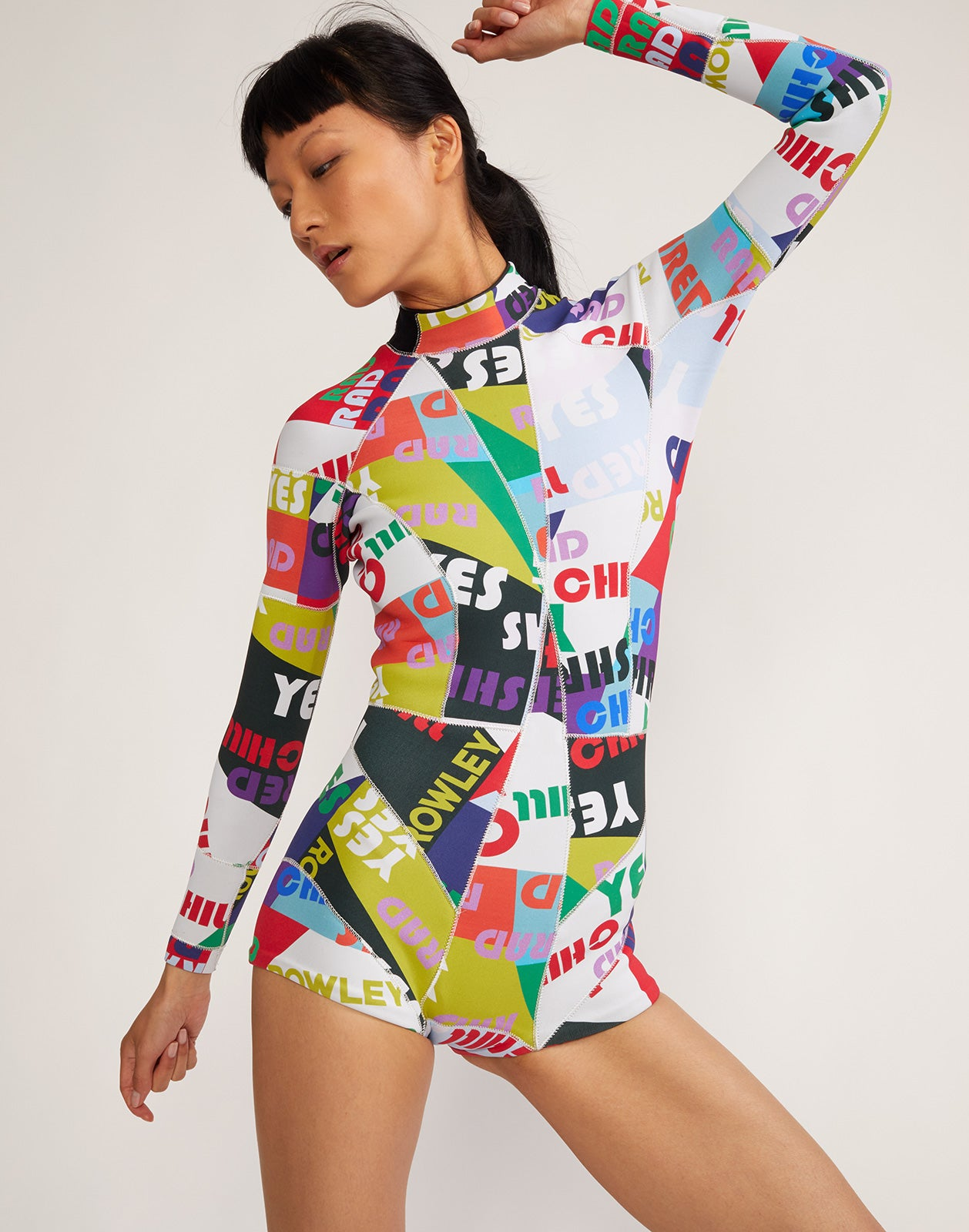 Alternate close view of Good Vibes neoprene wetsuit in vibrant graphic print.